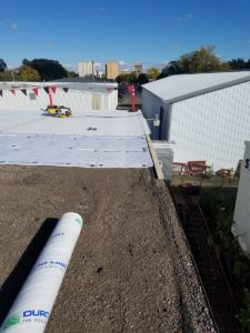 Before picture of a flat roof recover.